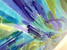 Detail, bathroom bespoke glass splash back. Handmade cast glass with surface texture.