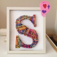 Teach kids to love their names. A monogram made of crayons is an easy project and makes for adorable wall art. #DIY