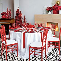 Red-and-White Christmas Table Decorations-Get inspired by this graphic take on a classic red-and-white theme. You can rent brightly hued Chiavari chairs to provide a luxe pop of color that's fit for the season. Christmas Table Settings, Christmas Tablescapes, Christmas Table Decorations, Holiday Tables, Christmas Events, Christmas Christmas, Wedding Decorations, Box Deco, Decoration Chic