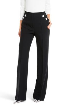 The perfect work-week separate, these black pants are given an unexpected edge with contrasting white buttons. The wide-leg virgin wool pair is finished with inset pockets and center front creases. A fitted turtleneck sweater will take it to a new level of chic.#MODELFIT Model is wearing size S, is 70.1'' tall with a waist circumference of 23.6''.#Contrast button detail|High waist|Inset pockets| Wide leg