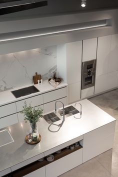 SieMatic PURE in lotus white, inox worktop, appliances Gaggenau
