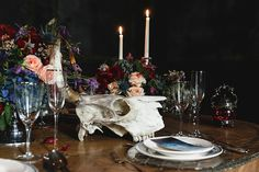 Skull centerpiece with flowers and candles | Mikhail Loskutov Photography | see more on: http://burnettsboards.com/2014/10/flowers-bones/