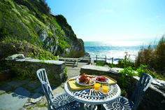 Downsteps Beach House is a charming and lovingly restored 200 year old beachside fisherman's cottage nestling in a secluded cove in Torcross on the South Devon coast between Dartmouth and Salcombe.