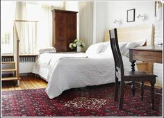 Oriental rug doesn't look too dark with lighter walls and linens. Should we do a lighter or darker painted floor?