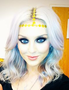 not a fan of all the makeup...but she has beautiful blue eyes
