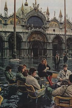 """""""When a November storm strikes, water smothers the Piazza San Marco… At a sidewalk café, students take the calamity in their stride."""" - National Geographic, 1972, photographed by Albert Molday"""