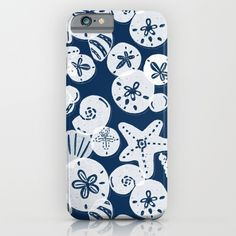Pretty white sea shells and sand dollars on a navy blue background.<br/> <br/> ocean, nautical, beach, sea...