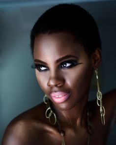 Awesome look: Start with a foundation that leaves the skin with a dewy, radian glow framed with a Crop Cut Natural. Finish with dramatically lines eyes and pink lips and top it all off with wire drop earrings and chain necklace. Groovy!
