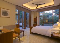 Relaxing Natural Resort With Beautiful Spa in China : Marble Floor Inspiring Hidden Lights Wooden Desk Lacquered Bed Frame