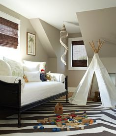 pinterest homes with daybeds | Adorable boys bedroom design with black cane faux bamboo daybed, cafe ...