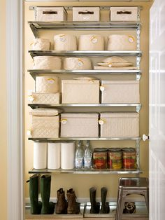 Clever Closet  Take advantage of every bit of basement space by assigning a metal storage unit to house accessories. Restore order by stacking seldom-used items, such as glassware and extra china, into zippered bins on shelves and clearly labeling them with decorative tags. Two trays placed beneath the unit provide the perfect spot for a row of work boots and shoes