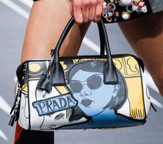 672197e5447f Prada's Spring 2018 Runway Bags Included Lots of Nylon and a Cast of Female  Comic Heroes