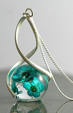 Eco-friendly resin, turquoise flowers, sterling necklace.