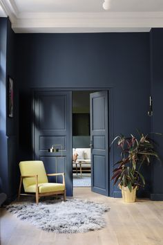 Black painted wall. Yellow armchair. | The Good Hacienda | curated by Hilary