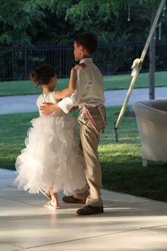 My little luv bugs! Justin, the ring bearer & Talia my flower girl! I had talia's dress custom made to match my dress!