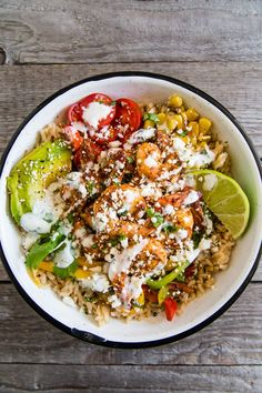 These chipotle shrimp fajita bowls are full of chipotle lime shrimp, rice, sauteed vegetables, and drizzled with a cilantro lime Greek yogurt sauce. Shrimp Recipes, Fish Recipes, Mexican Food Recipes, Dinner Recipes, Healthy Recipes, Chipotle Shrimp Recipe, Dinner Ideas, Chipotle Recipes, Spicy Shrimp
