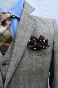 Rosette pocket square is one wink nice along with the whole color combo.