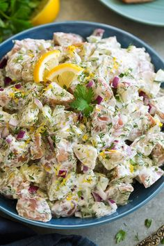 This Greek Potato Salad with a homemade tzatziki dressing is the most refreshing potato salad! It's deliciously creamy, it has lot's of fresh herbs, and that bit of lemon gives it the perfect summery