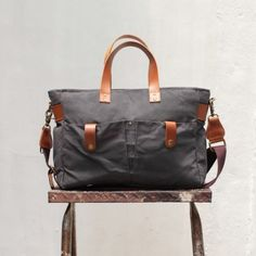 """Gouache Kahlo Tote Bag (Asphalt Grey). ripstop lining, water repellant, laptop divider and adjustable gadget dividers. fits 13"""" laptop with full frame camera. removable cotton straps. zipper lock feature. luggage sleeve. 100% cotton canvas, genuine leather."""