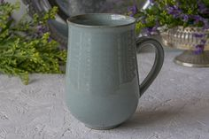 Light Steel Blue handmade pottery LARGE mugs are great for that extra shot of coffee, or a comforting and delicious boost of hot chocolate on a cold winter's day! What a thoughtful gift to bring you hostess! The mugs are made out of a beige speckled clay, trimmed with an attractive base. I then coated the surface with a light steel blue glaze.  The mug has been shaped so that it can comfortably fit between your hands. It has a small curve at the rim making for easy and comfortable sipping…