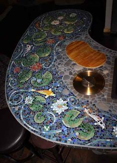 Mosaic kitchen counter!  withkoi fish and lotus flowers -cutting board, sink