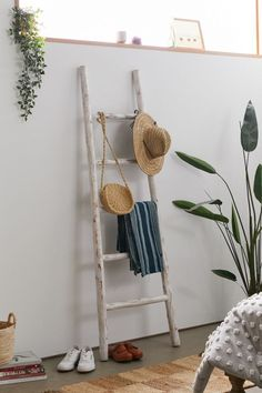 This blanket ladder is perfect for living room corner decor to fill an empty space! Living Room Corner Decor, Wooden Ladder Decor, Wooden Canopy, Wood Ladder, Urban Outfitters, Leaning Ladder, Diy Blanket Ladder, Ladder Toss, Diy Ladder