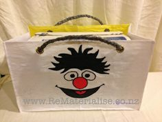 Ernie from Sesame Street, reusable grocery bag Made using 40 recycled plastic bags.  The ultimate in eco friendly, It saves you from getting more plastic bags and used up a huge quantity in its construction and diverts them from landfills and waterways. Each bag is strong and sturdy and built to last. Perfect for grocery shopping or a trip to the beach or pools.. perfect for picnics as any spills just wipe right off! The perfectly unique gift for anyone.  Includes Free shipping