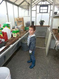 Cameron inside the greenhouse.