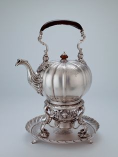 Kettle, stand and salver Silver Origin: London Date: 1754-1756 Marks/Maker: London, sterling standard, 1754-5 (the salver, 1755-6), maker's mark of Daniel Piers Heraldry: Arms of Dawson impaling Fermor for Thomas Dawson (1725-1813), who married in 1754 Lady Anne Fermor, daughter of Thomas, 1st Earl of Pomfret