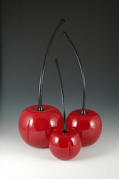 "Decoration for my eventual bar. ""Red Cherries"" Art Glass Sculpture created by Donald Carlson Larger than life and delectably detailed, each of these brilliant red blown glass cherries is accented by an arcing stem of black glass. Each piece is unique."