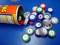 Math Facts Bottle Cap Match.  Oh the ideas...counting for kinders, addition and subtraction for littles, and multiplication and division for bigs.  More math in our library.