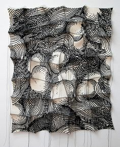 Textile artist Chung-Im Kim silk screens patterns onto industrial felt pieces, hand stitching the felt to create dimensional wall sculptures that seem to sway – an illusion made more convincing by the combination of surface pattern and clever stitching