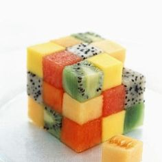 "French page, roughly translated ""A fresh and juicy dessert: the fruit Rubik's cube."" No recipe, but it seems to me to be watermelon, cantaloupe, pineapple, papaya, kiwi, and dragon fruit."