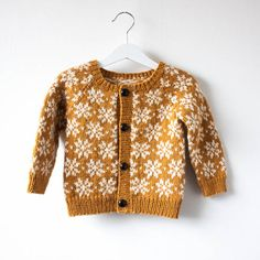 Ababy and toddler knitting pattern to make a colour work cardigan, the cardigan is knit in the round and steeked open. The cardigan is finished by either sewing in a lining or enclosing the cut ed…