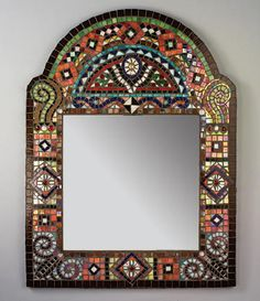 This beautiful mosaic mirror was created by a husband and wife team. It will compliment a range of wall colors.