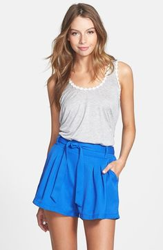 Free shipping and returns on PPLA Tie Waist Pleat Textured Shorts (Juniors) at Nordstrom.com. Inverted pleats and a chic tie waist elevate a pair of flowy shorts knit with dimension-giving texture.