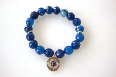 Blue bead stretch bracelet with gold evil eye boho by VibeJewels, $18.00