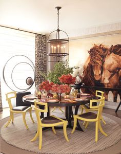 A neutral space in brown and cream with just a pop of bold yellow. Dining room design by Thom FIlicia in House Beautiful