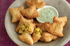 Vegetable samosas Puff pastry filled with spiced potatoes and vegetables.