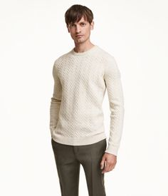 Long-sleeved cable-knit sweater in lambswool with a rounded neckline and ribbing…