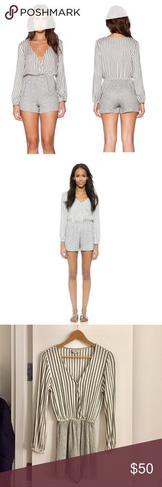 """LIV Claude Romper from Revolve LA based brand LIV. Sold on Revolve and shopbop. Super cute romper in off white and heather grey stripe. Features elasticized waist and snap front for more modesty. I'm 5'2""""/5'3"""" 105 lbs and size XS on me fits like the model in first pic. Would fit size 00-0. I wore it with leather moto jacket and ankle booties. Not from Aritzia. Aritzia Dresses Mini"""