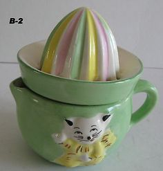 This adorable child's or baby reamer isclassified as a B-2 in the Walker books. It's a lovely pastel green with an adorable white kittens on the front. There is some slight paint wear on the bottom t