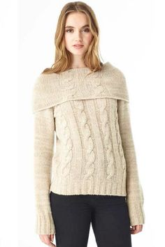 This luxurious cowlneck pullover is understated glamour. With 4 plys of luxurious cashmere it is hand knit in Los Angeles, finished with rib trims and cabling throughout. It has a beautifully fitted body and large cowl that can be worn round the neck or pulled down to wrap around the shoulders.