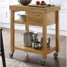 Features:  -Bottom shelf provides ample storage space.  -Castors provide for easy mobility.  -Clean with mild detergent.  -Cabin style.  -Wheel do lock.  -Open storage.  Product Type: -Kitchen Cart.