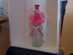 Cancer Awareness Winelight...pink lights (see other pics), frosted clear bottle, gems painted pink in shape of ribbon surrounding the neck/front of bottle, crystal ribbon charm, pink ribbon on front with hand wrapped copper wire jewelry hanger around neck, hand painted ribbon on back of bottle plus cute acyrlic diamond bottle topper with feather neck choker and pink  pink satin raffia ribbon to make this bottle complete!  $35.00