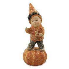All Spooked Out by Bethany Lowe. $18.50. Resin and felt baby on pumpkin covered in mica glitter. 5-1/2 x 2. Designed by Maggie's Memories.