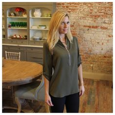 """Olive zipper detail blouse Modeling size small, available in S. Bust laying flat: S 19"""" M 20"""" L 21"""", length S 27.5""""/28.5"""" M 28.5""""/29.5"""" L 29.5""""/30.5"""". 100% polyester. ✨please allow me to make you a personal listing. Just comment size needed. All listings should have updated sizes available in the listing. I discount bundles of two or more items.  Please allow me to make your bundle listing for you with your size requests rather than using the feature ✨LT901200 Tops Blouses"""