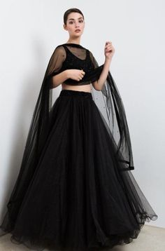 Black skirt with sequins embroidered blouse set with a dupatta. The lehenga choli is a custom made garment which includes the blouse(top), lehenga (skirt) and the dupatta (stole). Skirt and stole are in soft net and the blouse has sequins embroidery. It can be customised in any color of your