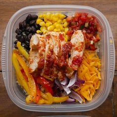 CHICKEN BURRITO BOWL Serves 4-6 INGREDIENTS  2-3 boneless skinless chicken breasts 3 bell peppers, any color, sliced 1 large red onion, sliced 2 tablespoons olive oil 1 tablespoon taco seasoning Salt and pepper 1 jar salsa 3 cups cooked brown rice, divided 1 can black beans, drained and rinsed 1 can corn 1 cup shredded cheddar cheese 1 lime, sliced into wedges  Fresh cilantro to garnish  PREPARATION 1. Preheat oven to 400˚F/200˚C. 2. Line a baking sheet with foil. 3. Place the chicken…