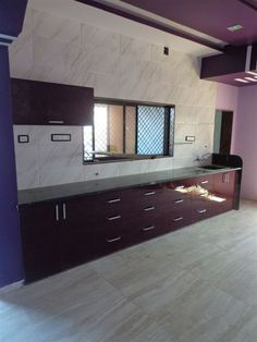 these is a straight kitchen  with  big baskets and cp finish  handle in padra area ,which is outskirts of  baroda city, for more information and free estimate at your site plz  visit www.enconsindia.com   and send pic on whatzup  or call   on 09824083905